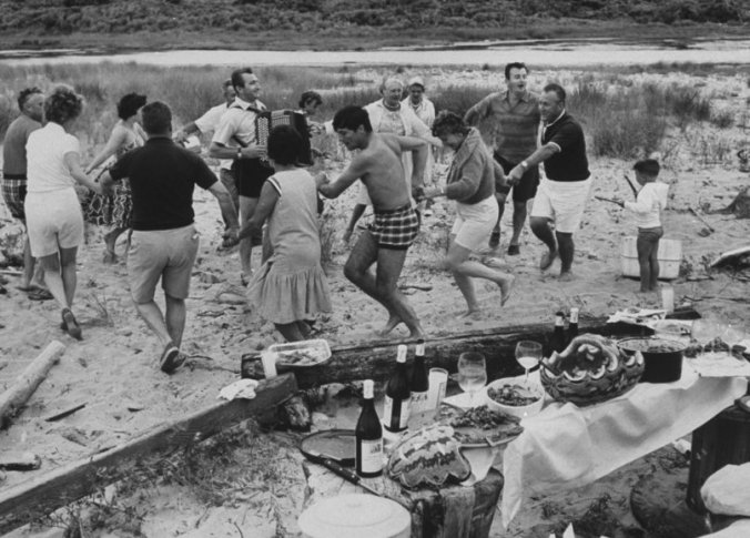 Howard Johnson VP Pierre Franey (L), Jacques Pepin (C), Roger Fessaguet (2nd R) and Jean Verqnes joining in on the ring dance after the consumption of their picnic.  (Photo by Mark Kauffman/The LIFE Images Collection/Getty Images)